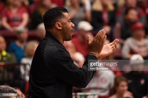 Seattle Seahawks quarterback Russell Wilson whose sister is a guard for Stanford cheers during the NCAA women's basketball game between the Oregon...