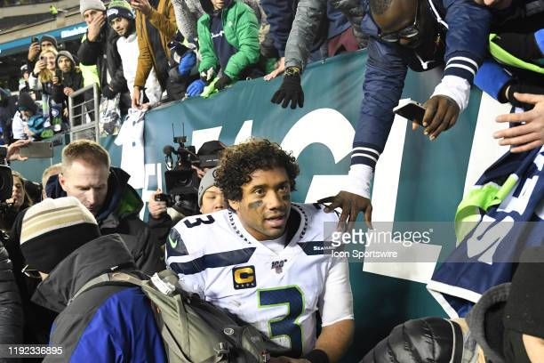 Seattle Seahawks quarterback Russell Wilson with fans during the Playoff game between the Seattle Seahawks and the Philadelphia Eagles on January 5...