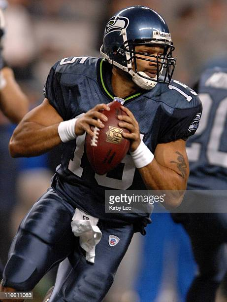 Seattle Seahawks quarterback Seneca Wallace drops back to pass during 16-0 victory over the Oakland Raiders in ESPN Monday Night Football game at...