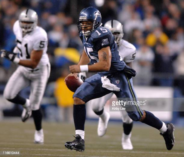Seattle Seahawks quarterback Seneca Wallace scrambles during ESPN Monday Night Football game against the Oakland Raiders at Qwest Field in Seattle,...
