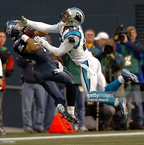 Seattle Seahawks receiver Seneca Wallace hauls in a long pass as Carolina Panthers cornerback Ken Lucas defends on the play in the first quarter of...