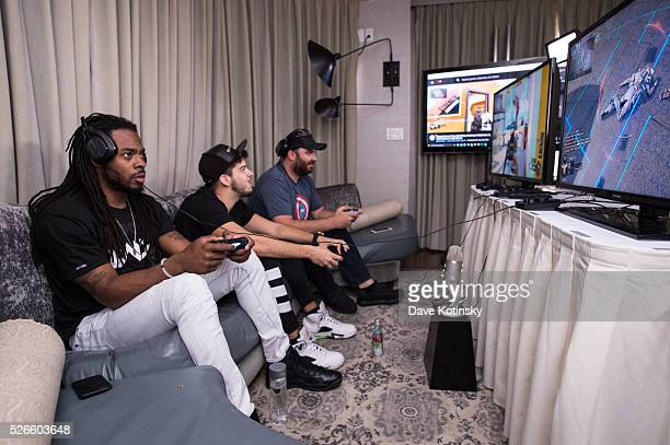 Seattle Seahawks Richard Sherman challenges Hike the Gamer in Call of Duty Black Ops 3 with Typical Gamer on April 30 2016 in New York City