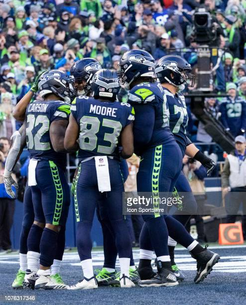 Seattle Seahawks Running Back Chris Carson celebrate a touchdown with his teammates Seattle Seahawks Wide Receiver David Moore Seattle Seahawks...
