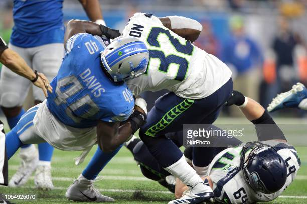 Seattle Seahawks running back Chris Carson is tackled by Detroit Lions linebacker Jarrad Davis during the second half of an NFL football game in...