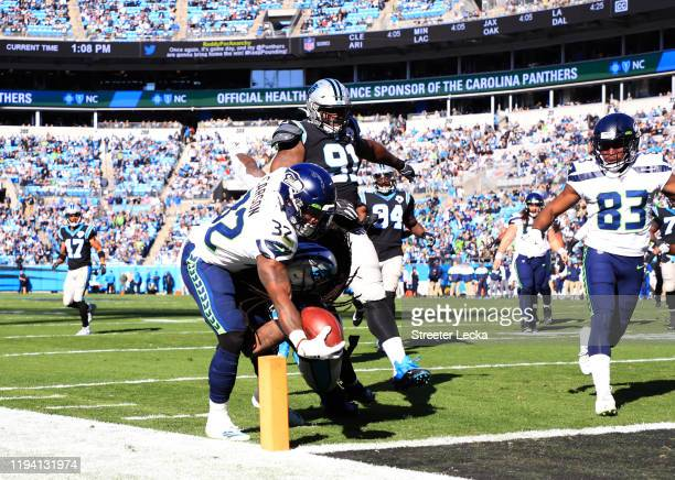 Seattle Seahawks running back Chris Carson scores during the first quarter against Carolina Panthers at Bank of America Stadium on December 15, 2019...