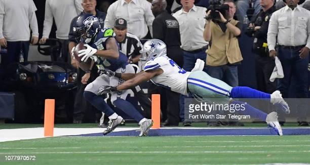 Seattle Seahawks running back JD McKissic catches a fourthquarter touchdown pass in front of Dallas Cowboys cornerback Byron Jones in a NFL Wild Card...