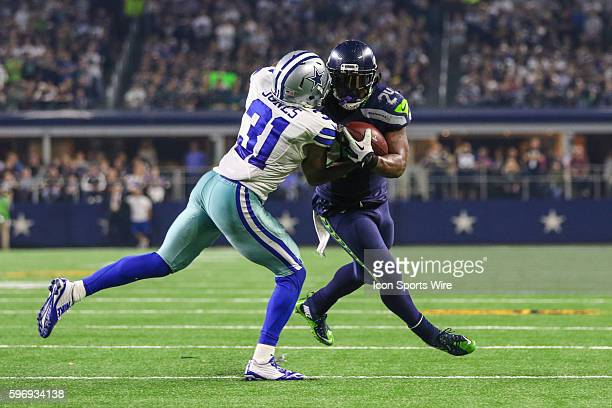Seattle Seahawks running back Marshawn Lynch gets tackled by Dallas Cowboys cornerback Byron Jones during the game between the Dallas Cowboys and the...