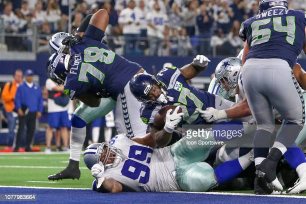 Seattle Seahawks running back Mike Davis scores a 2point conversion during the NFC wildcard playoff game between the Seattle Seahawks and Dallas...