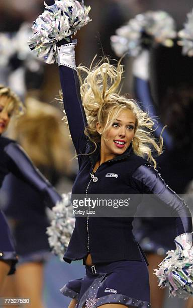A Seattle Seahawks Sea Gals cheerleader performs during NFC Wild Card Playoff game against the Dallas Cowboys at Qwest Field in Seattle Wash on...