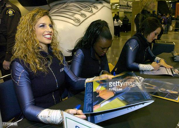 Seattle Seahawks Sea Gals cheerleaders sign autographs at Touchdown City at the Qwest Field Event Center before NFC Wild Card Playoff game against...