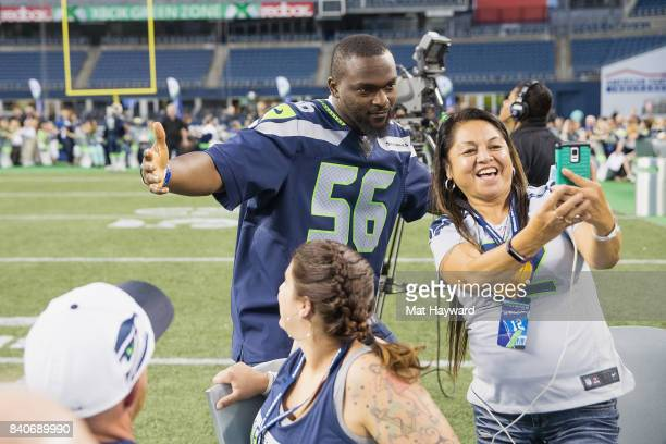 Seattle Seahawks star Cliff Avril greets hundreds of fans and Seattle business owners during American Express Dinner on the 50 at CenturyLink Field...