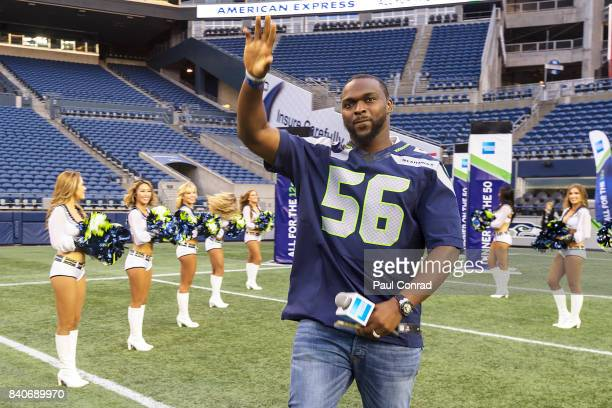 Seattle Seahawks star Cliff Avril waves to the crowd as he enters CenturyLink Field during the American Express Dinner on the 50on August 29 2017 in...