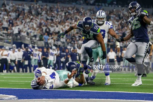 Seattle Seahawks strong safety Bradley McDougald tackles Dallas Cowboys quarterback Dak Prescott just short of the goal line during the NFC wildcard...