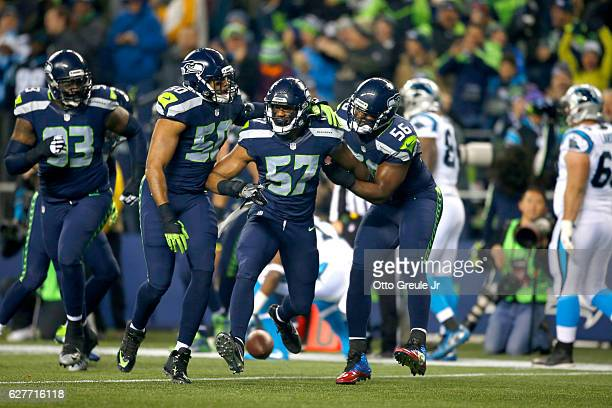Seattle Seahawks teammates congratulate linebacker Mike Morgan after he intercepted a pass against the Carolina Panthers at CenturyLink Field on...