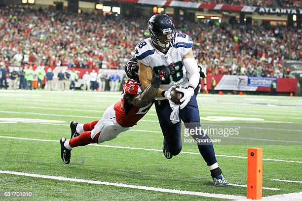 Seattle Seahawks tight end Jimmy Graham goes in for a touchdown during the first half of the NFC Divisional Playoff game between the Seattle Seahawks...