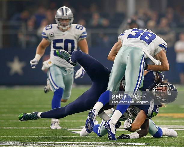 Seattle Seahawks tight end Luke Willson is sandwiched between Dallas Cowboys strong safety Jeff Heath and cornerback Morris Claiborne during the...