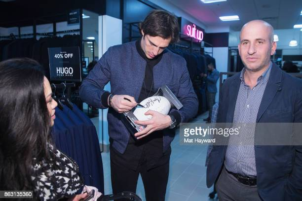 Seattle Seahawks Tight End Luke Willson signs an autograph for a fan during the Saks OFF 5TH Seattle VIP Grand Opening Party on October 18 2017 in...