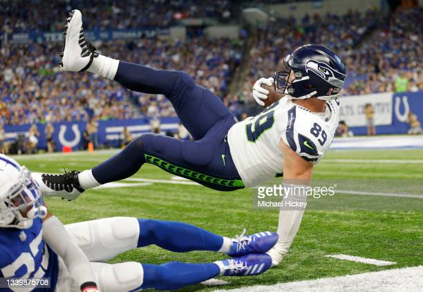 Seattle Seahawks tight end Will Dissly is tackled on the sideline during the first half against the Indianapolis Colts at Lucas Oil Stadium on...