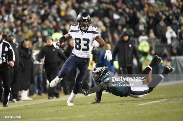 Seattle Seahawks wide receiver David Moore breaks a tackle by Philadelphia Eagles defensive end Derek Barnett during the Playoff game between the...