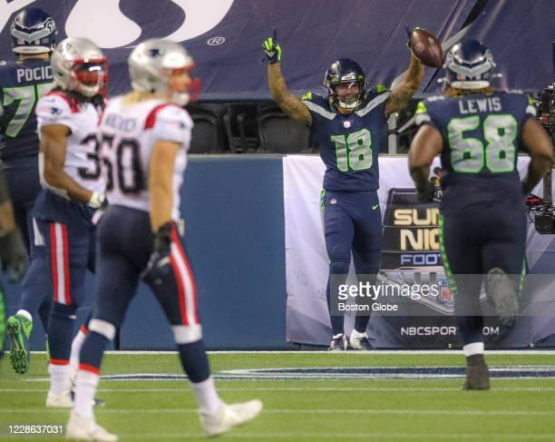 Seattle Seahawks wide receiver Freddie Swain celebrates his touchdown reception with teammate offensive guard Damien Lewis against the New England...