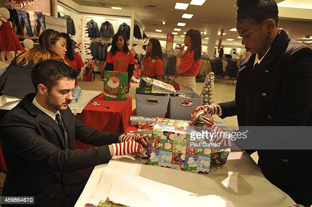 Seattle Sehawks safety Earl Thomas left reads a Christmas gift list on December 2 2014 in Seattle Washington Seattle Seahawk Earl Thomas Surprises...