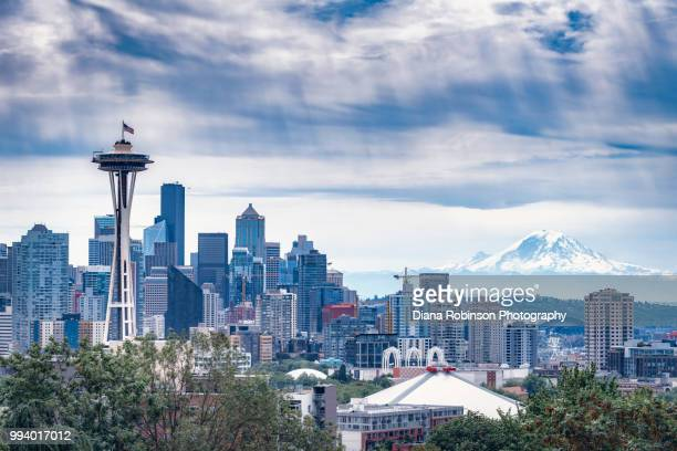 seattle skyline with american flag on space needle on the fourth of july from kerry park, washington - シアトル ストックフォトと画像
