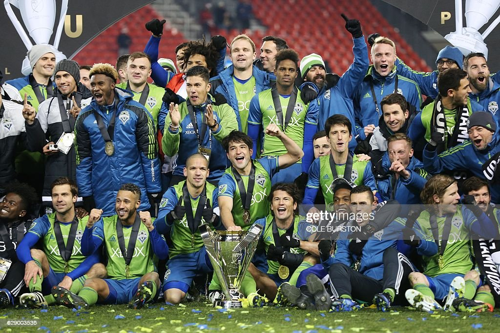 Seattle Sounders celebrate their MLS Cup final victory over Toronto FC at BMO Field on December 10, 2016 in Toronto. / AFP / Cole Burston