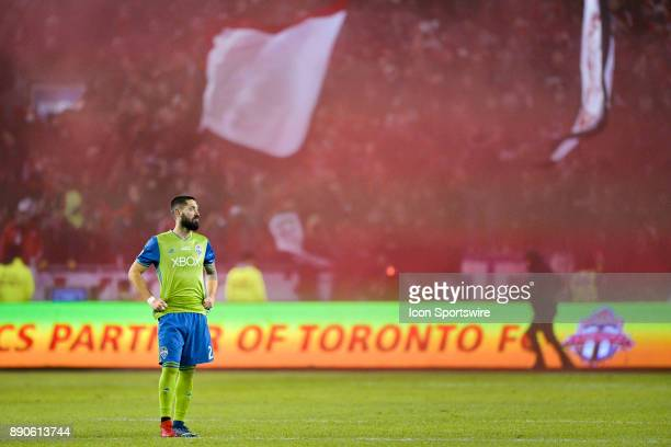 Seattle Sounders Defender Clint Dempsey stands in front of Toronto FC Fans celebrating the team's first goal by Jozy Altidore during the MLS Cup...