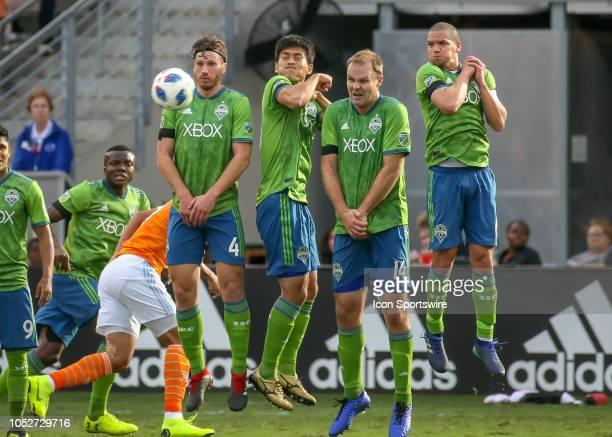 Seattle Sounders defender Gustav Svensson Seattle Sounders midfielder Kim KeeHee Seattle Sounders defender Chad Marshall and Seattle Sounders...