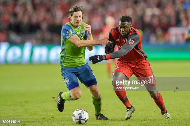 Seattle Sounders Defender Gustav Svensson ties up Toronto FC Forward Jozy Altidore during the MLS Cup Final played between the Seattle Sounders and...