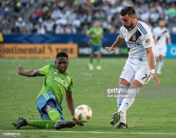 Seattle Sounders defender Kelvin Leerdam left blocks a pass by Los Angeles Galaxy midfielder Romain Alessandrini during the MLS regular season match...