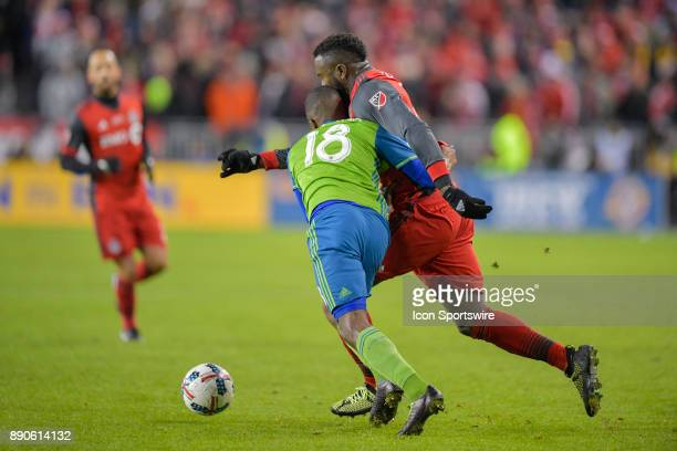 Seattle Sounders Defender Kelvin Leerdam puts his shoulders into Toronto FC Forward Jozy Altidore during the MLS Cup Final played between the Seattle...