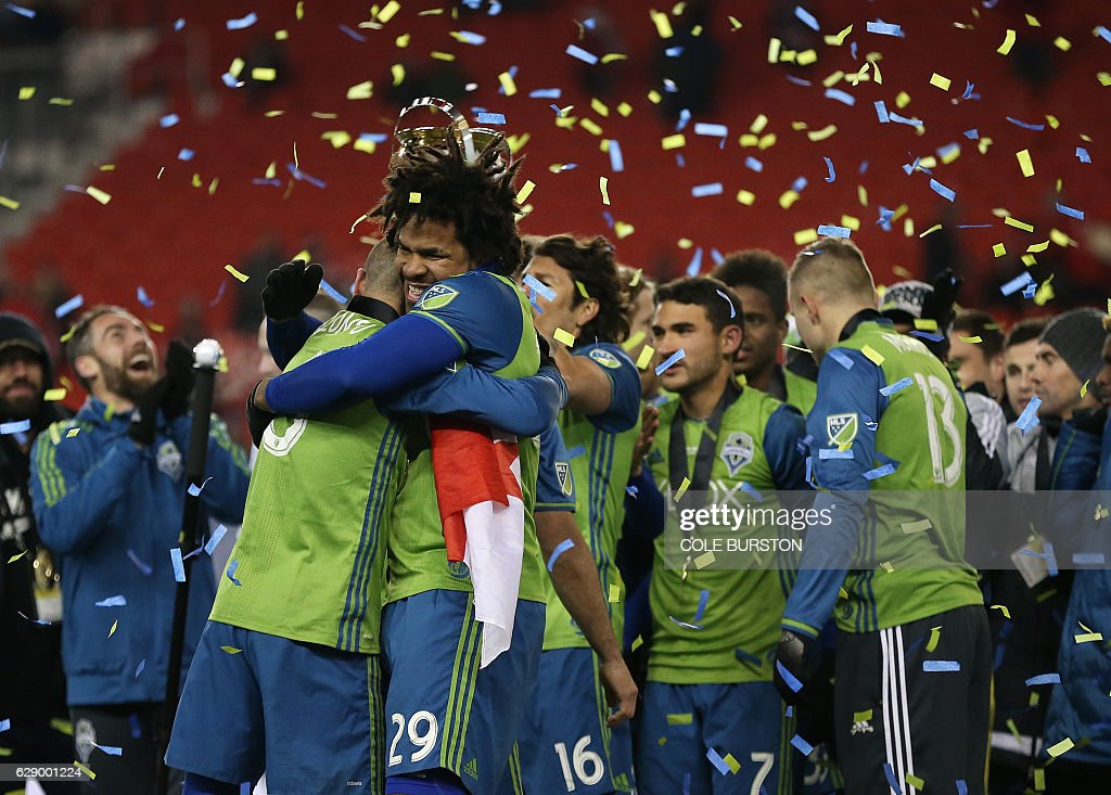 Seattle Sounders defender Roman Torres (29) celebrates alongside teammates their MLS Cup final victory over Toronto FC at BMO Field on December 10, 2016 in Toronto. / AFP / Cole Burston