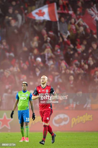 Seattle Sounders Defender Steven Beitashour stands stunned in front of Toronto FC Fans celebrating the team's first goal by Jozy Altidore as TFC...