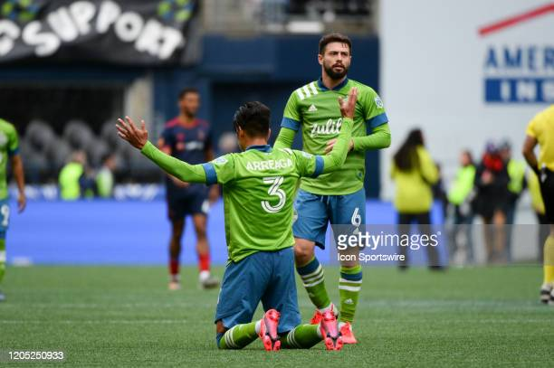 Seattle Sounders defender Zavier Arreaga celebrates a Seattle win with midfielder Joao Paulo after a MLS match between the Chicago Fire and the...