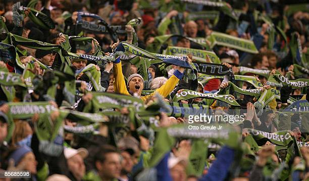 Seattle Sounders fans celebrate their second goal by forward Fredy Montero against Real Salt Lake on March 28 2009 at Qwest Field in Seattle...