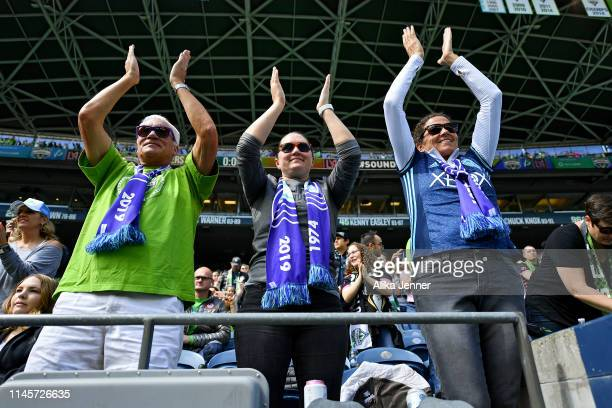 Seattle Sounders fans cheer on the home team before the match against the Los Angeles FC at CenturyLink Field on April 28 2019 in Seattle Washington...