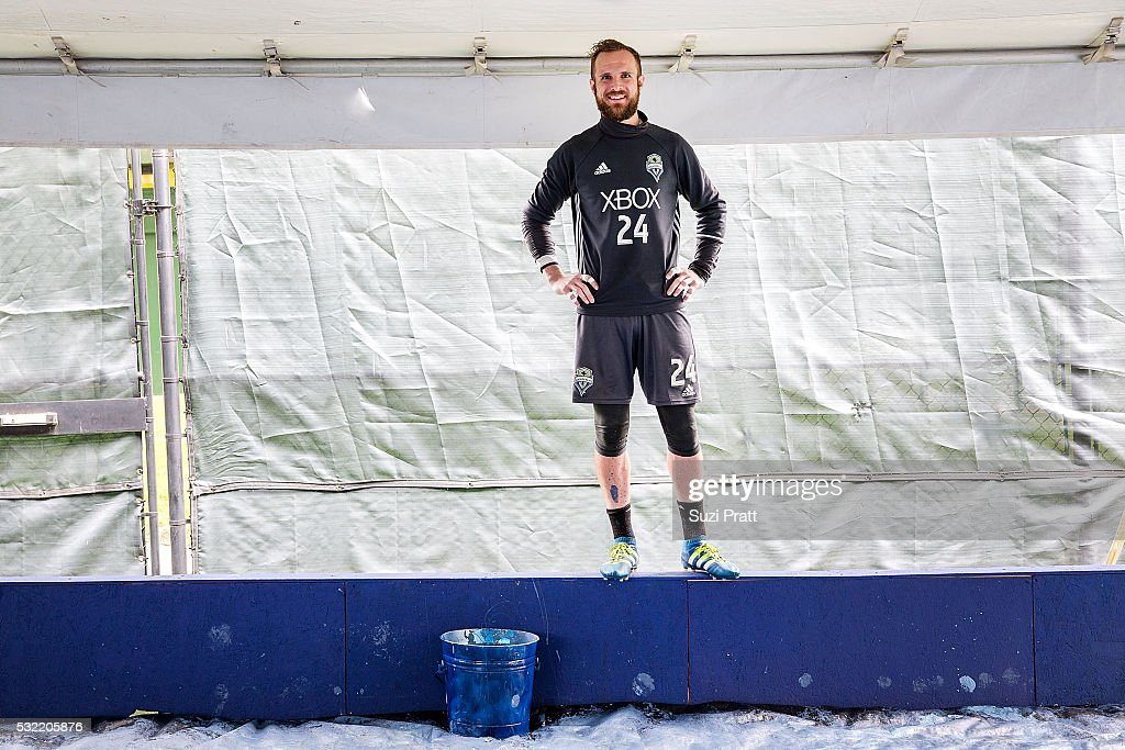 Seattle Sounders FC goalkeeper Stefan Frei looks over creation of the first piece of 'The Fabric Of Sounders FC' community project with Seattle Sounders FC and Delta Air Lines. on May 18, 2016 in Seattle, Washington.