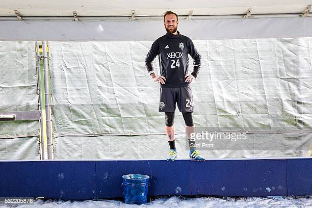 Seattle Sounders FC goalkeeper Stefan Frei looks over creation of the first piece of The Fabric Of Sounders FC community project with Seattle...