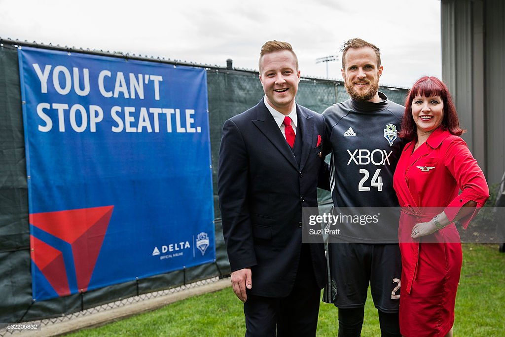 Seattle Sounders FC goalkeeper Stefan Frei poses with Delta Air Lines employees at 'The Fabric of Sounders FC' design project uniting community, art, and sport on May 18, 2016 in Seattle, Washington.