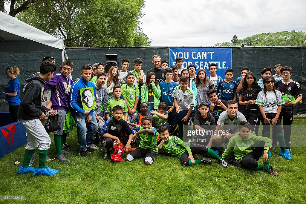 Seattle Sounders FC goalkeeper Stefan Frei poses with local art students from Voyager Middle School at 'The Fabric of Sounders FC' design project uniting community, art, and sport with Seattle Sounders FC and Delta Air Lines on May 18, 2016 in Seattle, Washington.