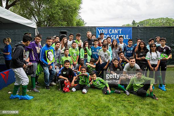 Seattle Sounders FC goalkeeper Stefan Frei poses with local art students from Voyager Middle School at 'The Fabric of Sounders FC' design project...
