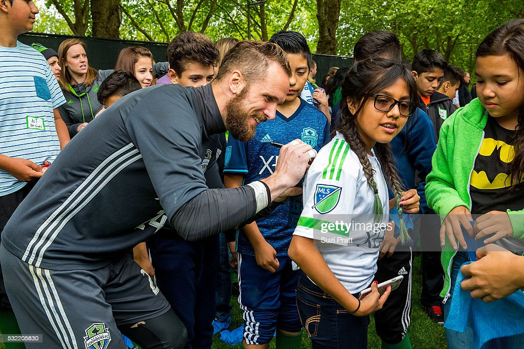 Seattle Sounders FC goalkeeper Stefan Frei with a local art student from Voyager Middle School at 'The Fabric of Sounders FC' design project uniting community, art, and sport with Seattle Sounders FC and Delta Air Lines on May 18, 2016 in Seattle, Washington.