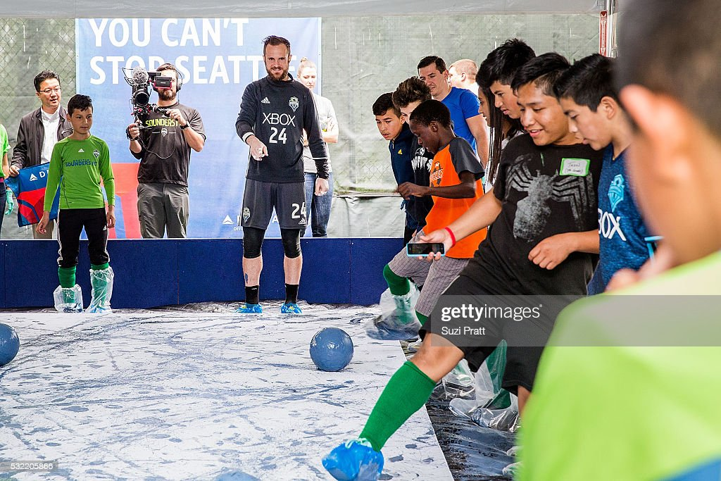 Seattle Sounders FC goalkeeper Stefan Frei with local art student from Voyager Middle School at 'The Fabric of Sounders FC' design project uniting community, art, and sport with Seattle Sounders FC and Delta Air Lines on May 18, 2016 in Seattle, Washington.