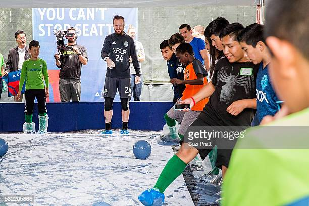 Seattle Sounders FC goalkeeper Stefan Frei with local art student from Voyager Middle School at The Fabric of Sounders FC design project uniting...
