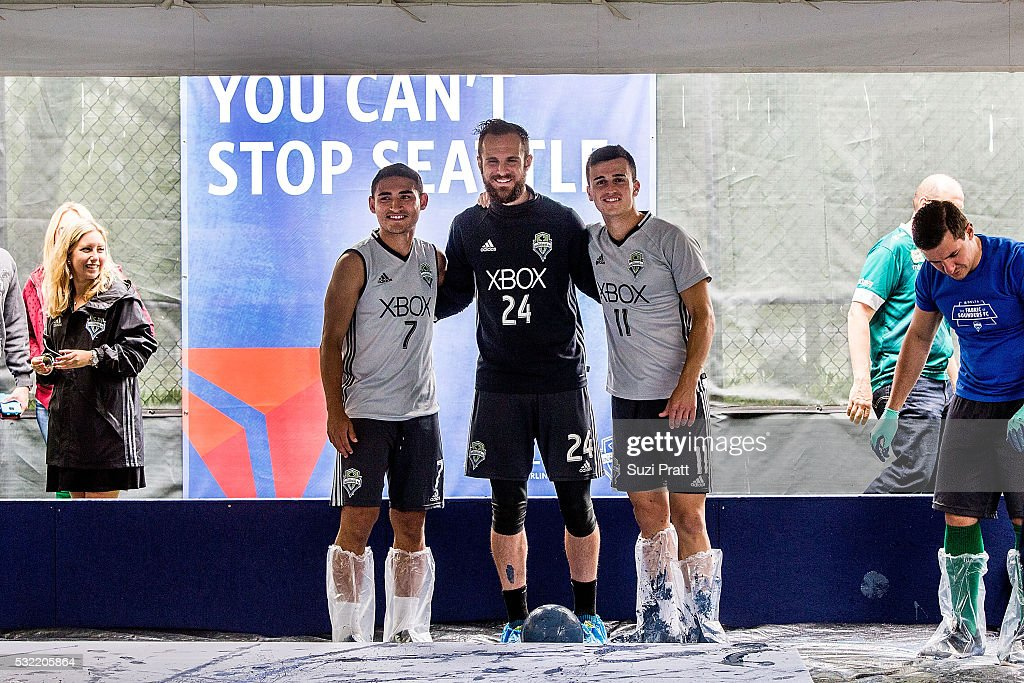 Seattle Sounders FC midfielder Cristian Roldan, goalkeeper Stefan Frei, and midfielder Aaron Kovar pose at 'The Fabric of Sounders FC' design project uniting community, art, and sport with Seattle Sounders FC and Delta Air Lines on May 18, 2016 in Seattle, Washington.