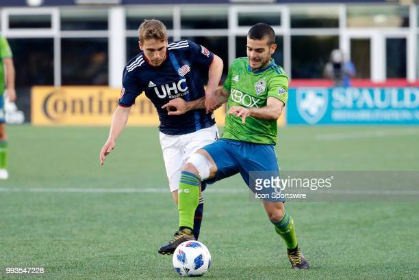 Seattle Sounders FC midfielder Victor Rodriguez steps in front of New England Revolution midfielder Scott Caldwell during a match between the New...