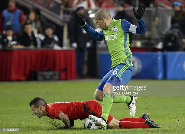 Seattle Sounders forward Herculez Gomez collides with Toronto FC forward Sebastian Giovinco during MLS Cup final at BMO Field on December 10 2016 in...