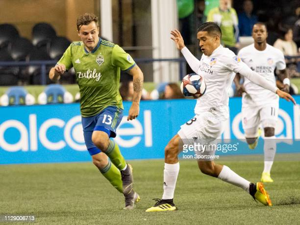 Seattle Sounders forward Jordan Morris battles for the ball against FC Cincinnati midfielder Victor Ulloa during the MLS regular season match between...