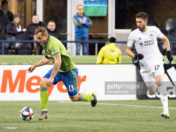 Seattle Sounders forward Jordan Morris dribbles the ball down field against FC Cincinnati defender Mathieu Deplagne during the MLS regular season...